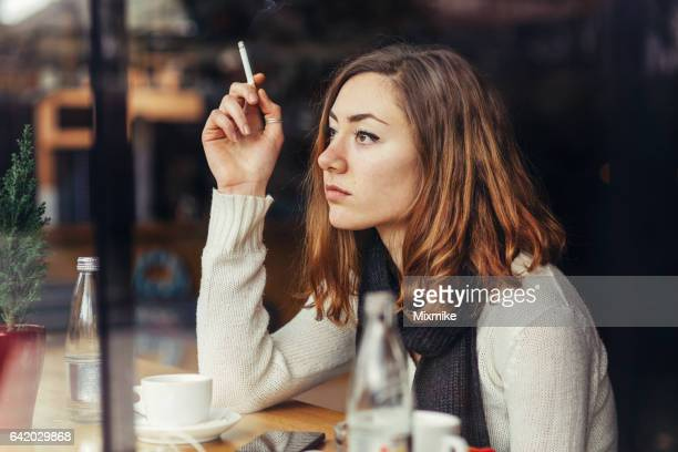 coffee and cigarette - little girl smoking cigarette stock photos and pictures