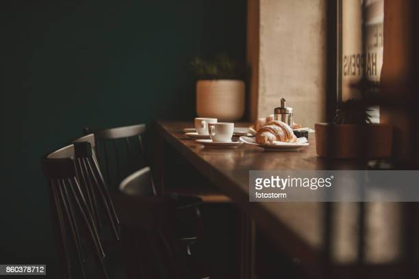 coffee and croissants for two - coffee shop stock pictures, royalty-free photos & images