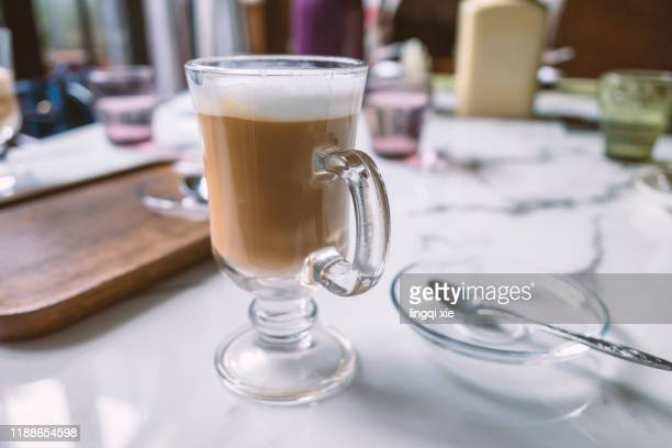 coffee and cutlery on the table in the cafe - mocha stock pictures, royalty-free photos & images