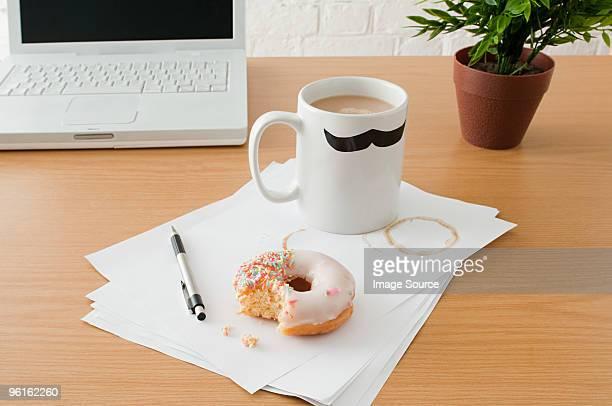 Coffee and doughnut on desk