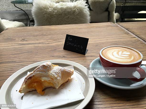 Coffee And Food With No Smoking Sign On Table