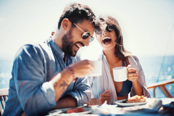 coffee and fun on the sailing. - couples romance stock pictures, royalty-free photos & images