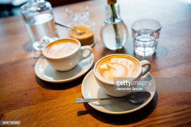 Coffee and glasses with water on the table in a coffee shop