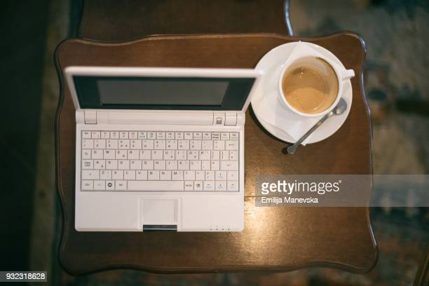 Coffee and Laptop on rustic table
