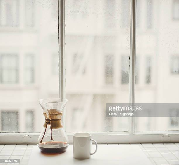 coffee and light - window sill stock pictures, royalty-free photos & images