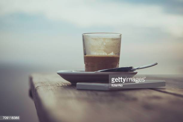 Coffee and mobile phone on table