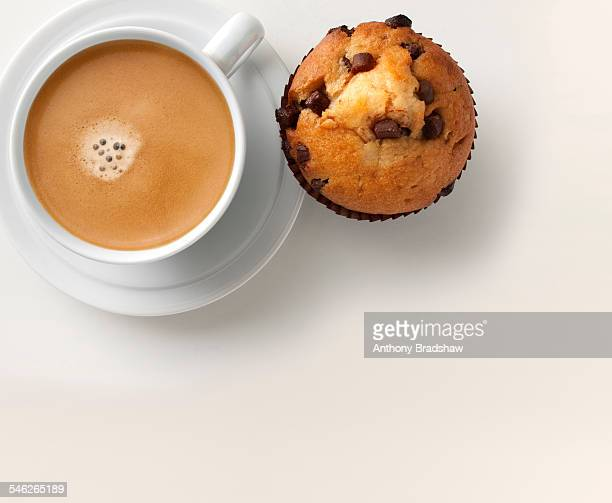 Coffee and muffin, overhead view