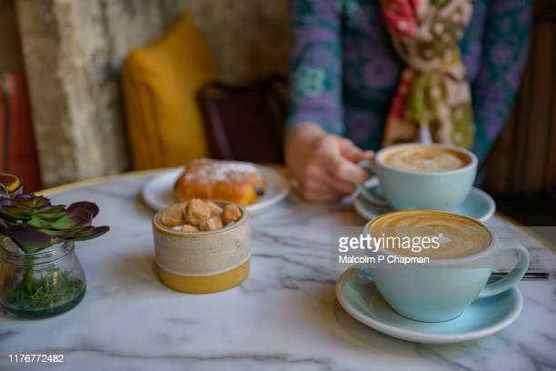 coffee and pain au chocolat - sweet pastry and coffee for breakfast - bath england stock pictures, royalty-free photos & images