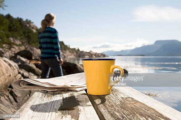 coffee and paper,woman in background - look back at early colour photography stock photos and pictures
