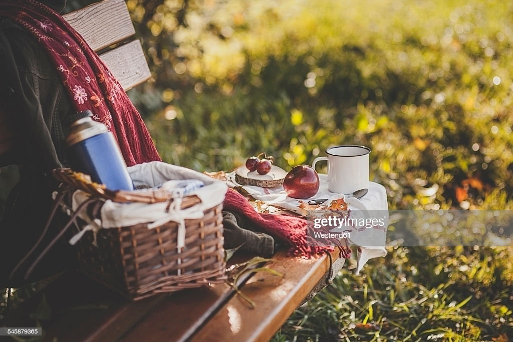 Coffee, apple, grapes and autumn leaves on wooden bench : ストックフォト