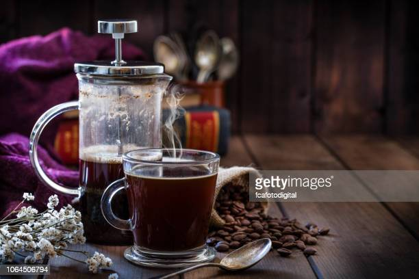 coffee backgrounds: coffee cup and coffee french press on rustic wooden table with copy space - coffee maker stock pictures, royalty-free photos & images