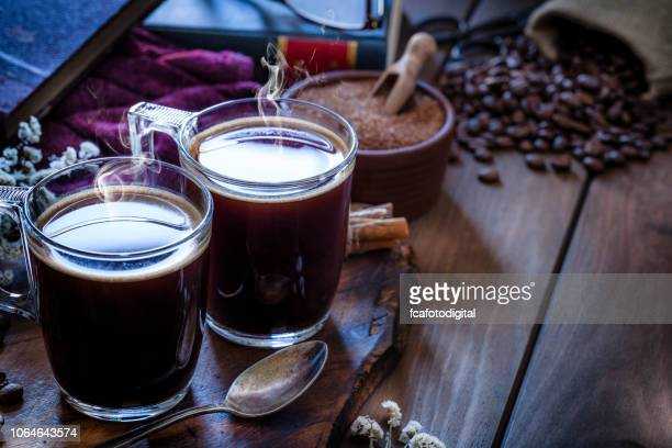 Coffee backgrounds: coffee cup on rustic wooden table with copy space