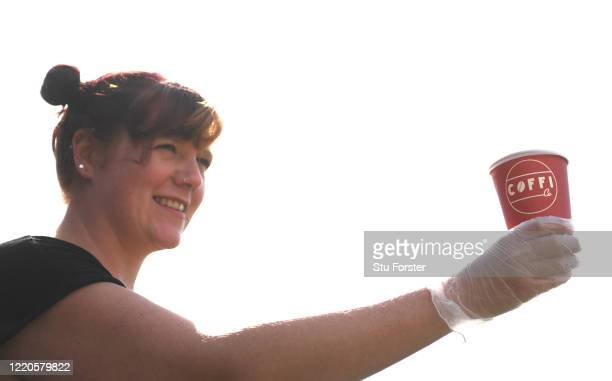 Coffee barista Gemma makes a drink as Coffi Co offer their Click and Collect social distancing system to it's customers on April 23 2020 in Cardiff...