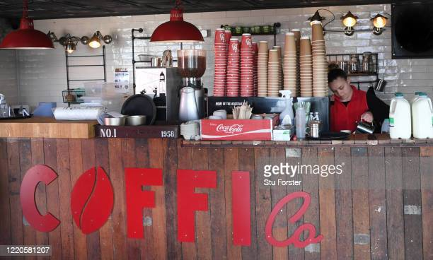 Coffee barista Jen makes a drink as Coffi Co offer their Click and Collect social distancing system to it's customers on April 23 2020 in Cardiff Bay...
