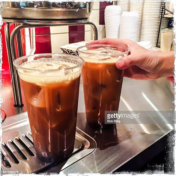 West Hollywood Ca February 6 2015 A coffee barista reaches for the nitro coffee just poured at Alfred's in west hollywood
