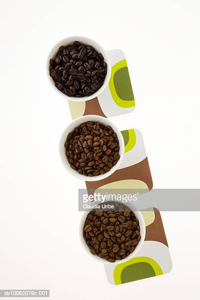 Coffee beans and coffee filters, overhead view