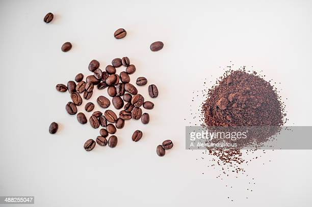Coffee beans and ground coffee isolated on white