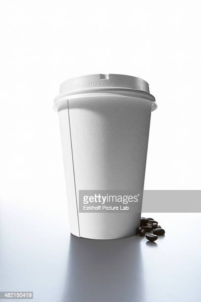 Coffee beans and paper cup