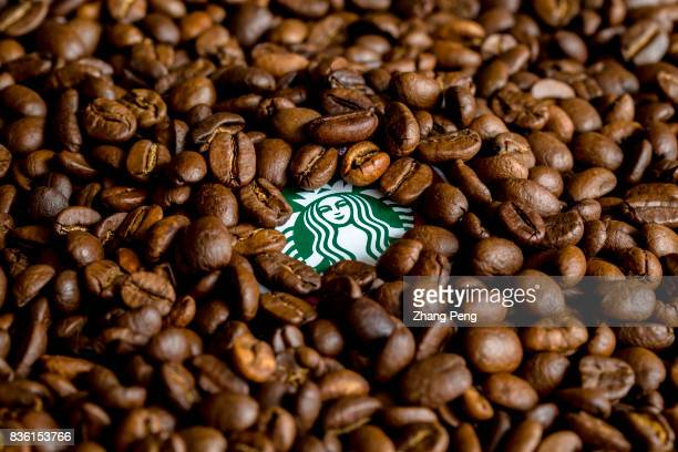 Coffee beans and Starbucks logo arranged for photography In the second quarter of 2017 the Starbuck's sales grew by 4% compared with the same period...