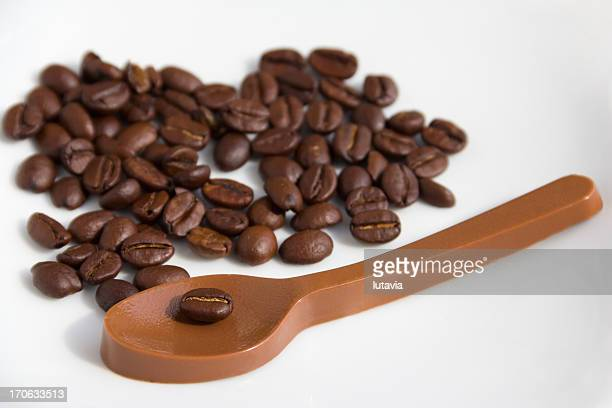 coffee beans and the chocolate spoon - lutavia stock pictures, royalty-free photos & images