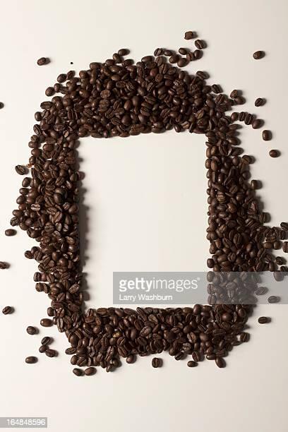 Coffee beans arranged around a rectangle shape