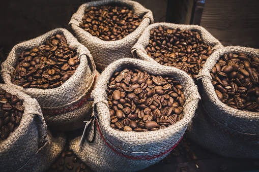Coffee beans in bags. 1055390644
