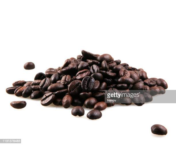 coffee beans isolated on white background - roasted coffee bean stock photos and pictures