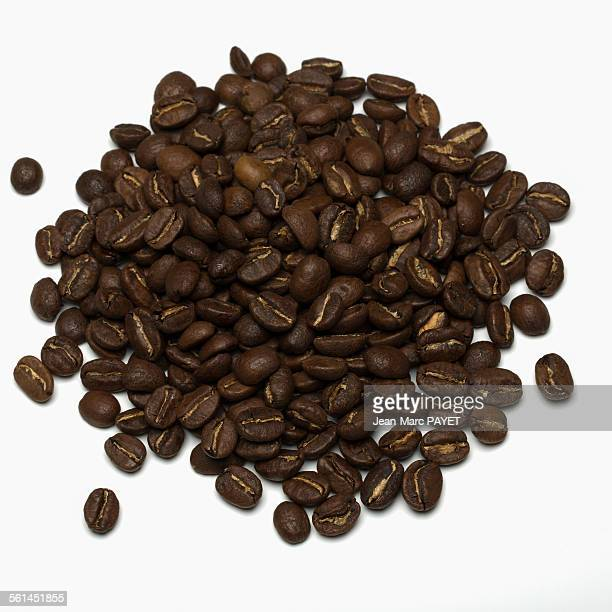 coffee beans on a white background - jean marc payet stockfoto's en -beelden