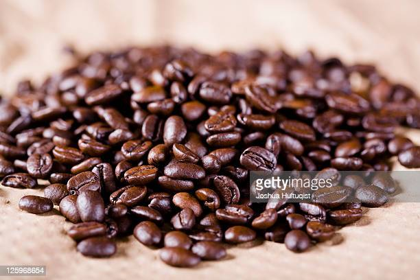 Coffee beans resting on brown paper
