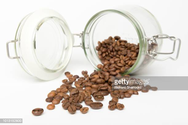 coffee beans spilling from jar - lying on side stock pictures, royalty-free photos & images