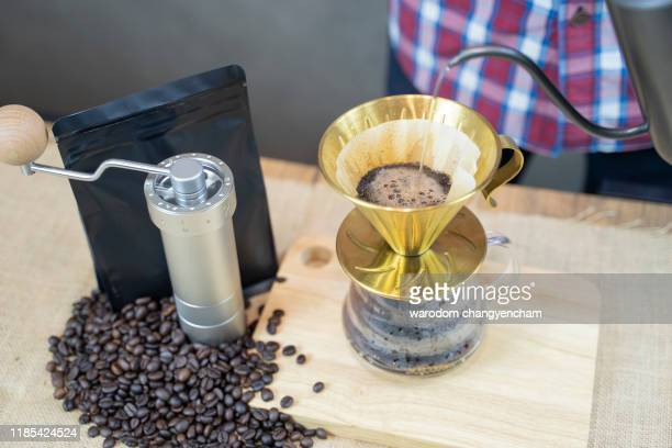 coffee beans that are ground inside the filter at the coffee level that is brewing coffee drip. - stain test stock pictures, royalty-free photos & images