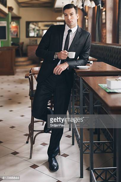 coffee before business - leather shirt stock pictures, royalty-free photos & images