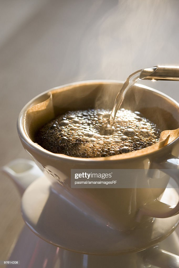 Coffee being poured into a cup : ストックフォト