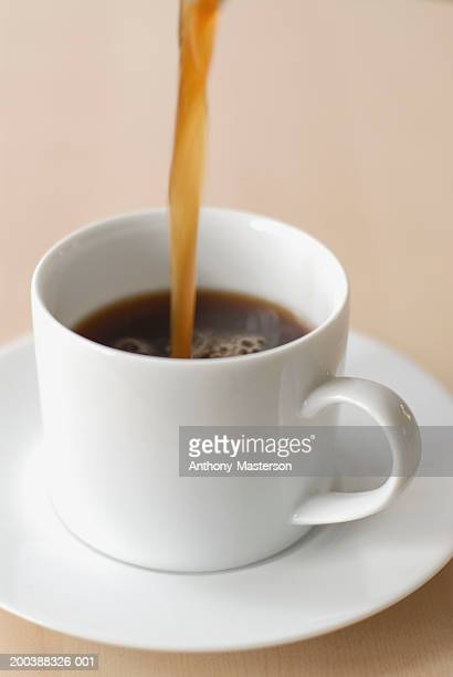 Coffee being poured into cup