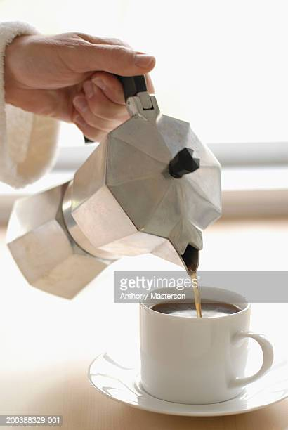 coffee being poured into cup - anthony-masterson stock pictures, royalty-free photos & images