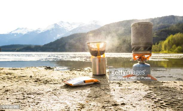 Coffee being prepared on camp stove on shore of Green Lake, Whistler, British Columbia, Canada