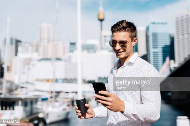 coffee break at yacht club for successful businessman - millionnaire stock photos and pictures