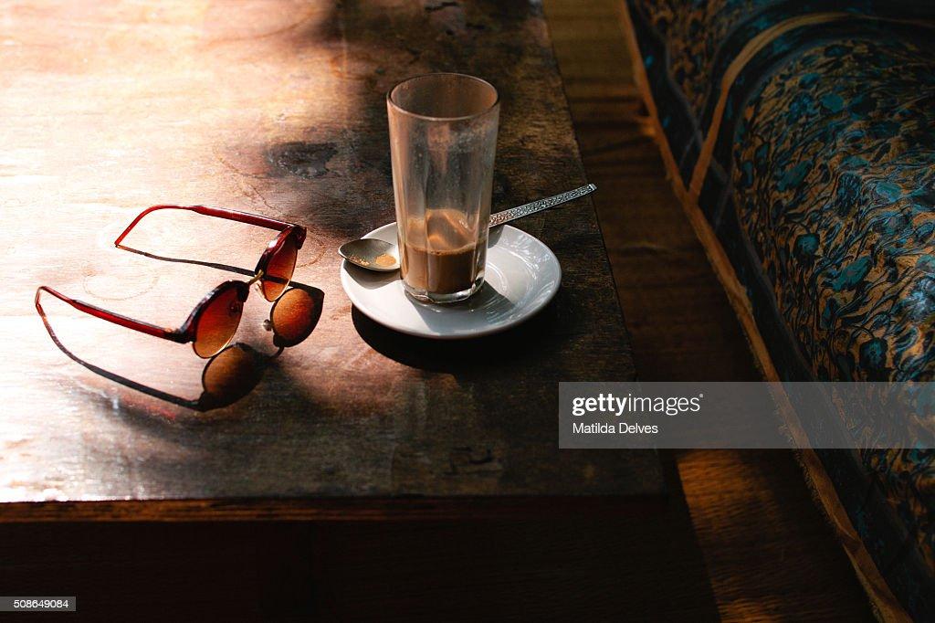 Coffee break. Glass of coffee on a table,Goa, India : Stock Photo