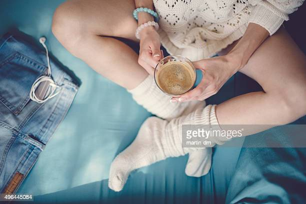 coffee break in bed - girls in socks stock photos and pictures
