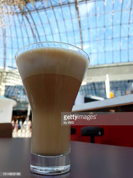 Coffee break in town against large atrium