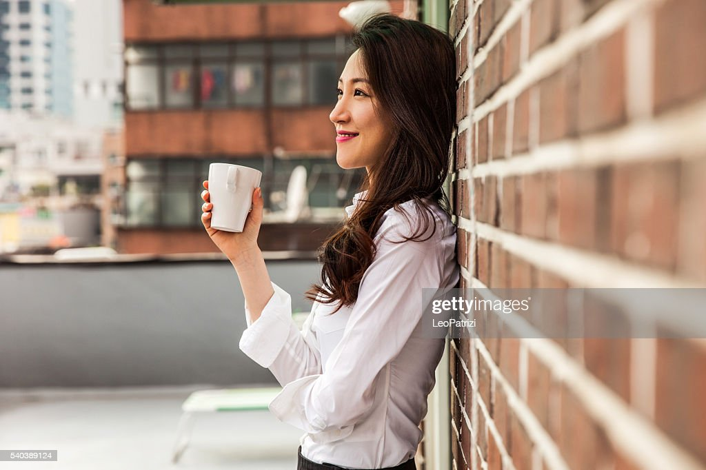 Coffee break on the Office rooftop in Seoul : Stock Photo