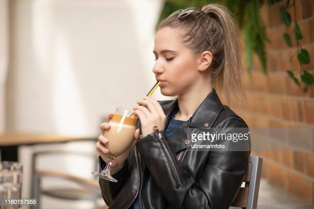 Coffee break .Young woman drinking coffee  Casual lifestyle