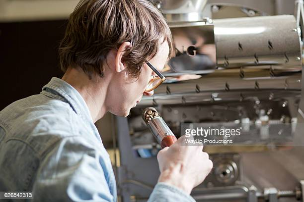 Coffee business owner sniffing coffee beans