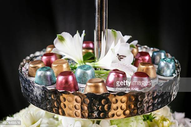 Coffee capsules are seen during the opening of the smallest popup cafe in town by NESPRESSO on October 13 2015 in Munich Germany