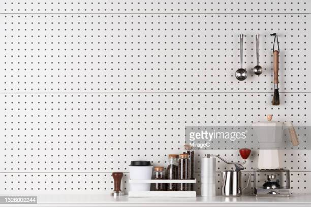 coffee corner on white pegboard wall - measuring spoon stock pictures, royalty-free photos & images