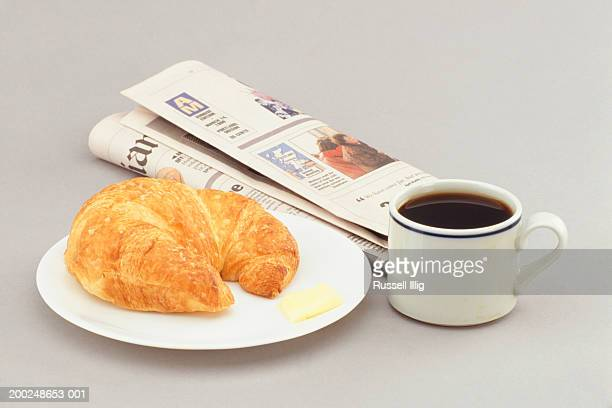 Coffee, croissant, and newspaper