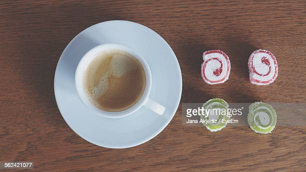Coffee Cup And Candies On Table