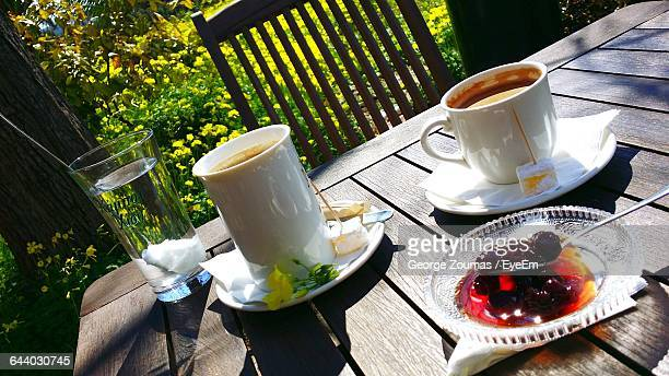 Coffee Cup And Cheery On Outdoor Breakfast Table