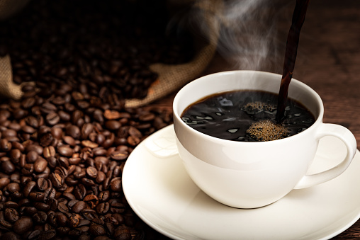 Coffee cup and coffee beans 1179920110