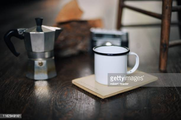 coffee cup and espresso maker on wooden floor - enamel stock pictures, royalty-free photos & images
